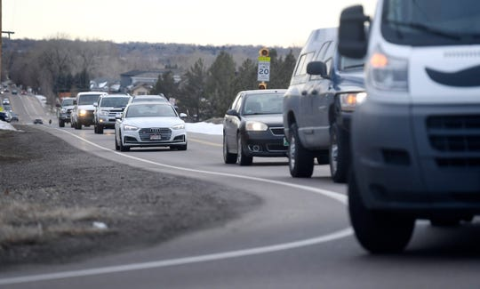 Traffic approaches the intersection of Country Club Road and North Lemay Avenue in Fort Collins, Colo. on Friday, Dec. 13, 2019.