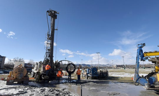 Crews drill a 550 foot bore hole in the corner of the intramural fields at Colorado State University as part of a geothermal project in Fort Collins, Colo. on Friday, Dec. 13, 2019.