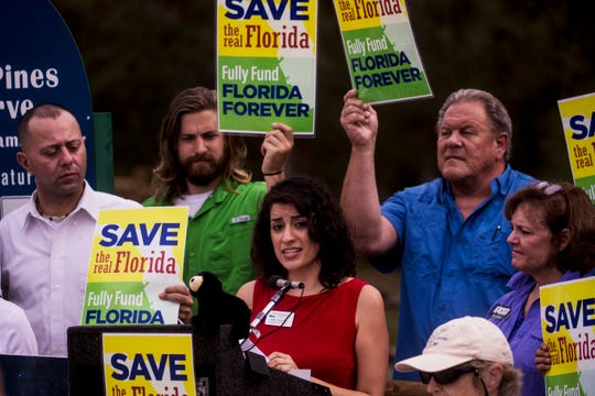 Gladys Delgadillo, representing the Conservancy of Southwest Florida, speaks at a press conference Friday, Dec. 13, 2019, at the Prairie Pines Preserve in North Fort Myers urging state leaders to fully fund Florida Forever. She was joined by environmentalists and others including ranchers.