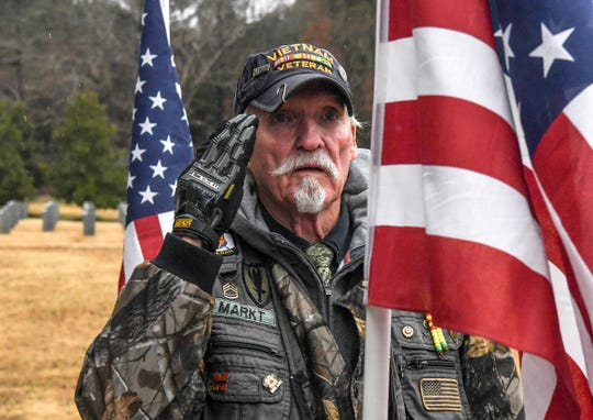 Rick Markt of Simpsonville salutes a U.S. flag he set up before the hearse with United States Army veteran William D. Rowland, 64, homeless in the Pickens area, arrived at Dolly Cooper Veterans Cemetery in Anderson Friday, December 13. Private Second Class Rowland was born 1955 in Pickens, enlisted in the United States Army in 1972 and later received a National Defense Service Medal as a rifle Sharpshooter.