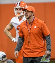 Clemson wide receiver coach Tyler Grisham communicates with players during practice at the Poe Indoor Facility in Clemson Friday, December 13, 2019. The Tigers are preparing for the College Football Playoffs semi-final game with Ohio State University played in Glendale, Arizona on December 28, 2019.