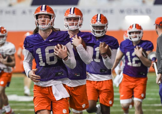 Clemson quarterback Trevor Lawrence (16) runs ahead of quarterback Chase Brice (7), quarterback Taisun Phommachanh(11), and quarterback Ben Batson(12) during practice at the Poe Indoor Facility in Clemson Friday, December 13, 2019. The Tigers are preparing for the College Football Playoffs semi-final game with Ohio State University played in Glendale, Arizona on December 28, 2019.