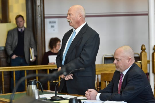 In this Thursday, Dec. 12, 2019, photo Roger Thompson, former Madison County Sheriff, appears before Judge Kathy Seeley Thursday in the Lewis and Clark County Courthouse in Helena, Mont. (Thom Bridge/Independent Record via AP)