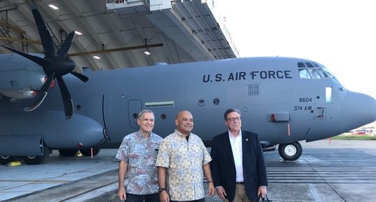 From left, U.S. Ambassador Robert Riley, Federated States of Micronesia President David Panuelo, U.S. Department of the Interior Assistant Secretary Douglas W. Domenech at the Operation Christmas Drop 2019 Push Ceremony at Andersen Air Force Base on Guam.