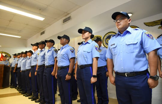 Twenty-three new Guam Police Department officers were sworn in during a ceremony at GPD's headquarters in Tiyan, Dec. 13, 2019.