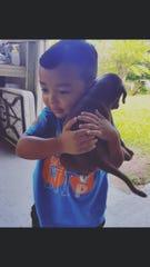 Connor Munoz holds Luna as a puppy in 2016.