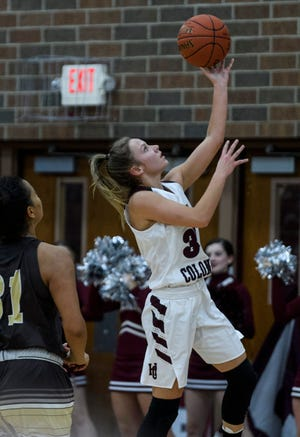 Henderson County's Emilee Hope (30) goes for a layup against the Central Bears at Henderson County High School in Henderson, Ky., Thursday, Dec. 12, 2019. The Colonels defeated the Bears, 54-28.