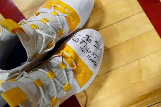 Iowa guard Jordan Bohannon's shoes sit on the court after an NCAA college basketball game against Iowa State, Thursday, Dec. 12, 2019, in Ames, Iowa. Iowa won 84-68. (AP Photo/Charlie Neibergall)
