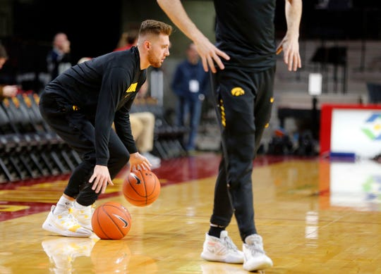 Iowa guard Jordan Bohannon warms up before his final game of the 2019-20 season Thursday night.