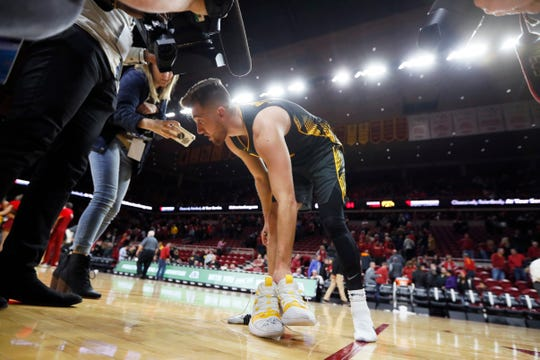Iowa guard Jordan Bohannon leaves his signed shoes on the court after an NCAA college basketball game against Iowa State, Thursday, Dec. 12, 2019, in Ames, Iowa. (AP Photo/Charlie Neibergall)