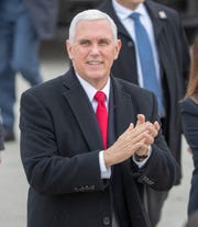 Vice President Mike Pence greets well-wishers on his visit to Indianapolis to meet with Governor Eric Holcomb, Indianapolis International Airport, Friday, Dec. 13, 2019.
