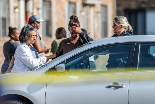 Family and friends arrive on the scene after a 16-year-old boy and his 15-year-old sister were victims of a double homicide in the 4100 block of Windhill Dr., in the Postbrook Appartments on Thursday, Aug. 23, 2019.