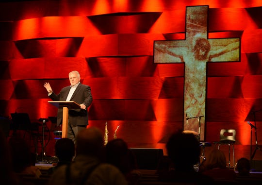 Randy Carter, of Northside Assembly of God, speaks to the congregation on breaking down the walls between themselves and their neighbors at Fellowship Bible Church during the Community Holy Week Services in 2014.