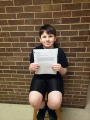 Bearden Middle School student Caleb Hill holds up a letter he has written encouraging legislators to pass a bill making studying the events of 9/11 mandatory in Tennessee schools.