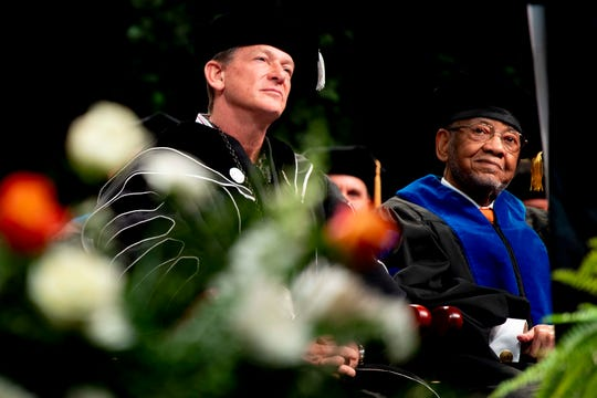 University of Tennessee interim President Randy Boyd and honorary degree recipient Theotis Robinson Jr. listen to the program at the UT winter graduation ceremony in Thompson-Boling Arena in Knoxville on Friday, Dec. 13, 2019.