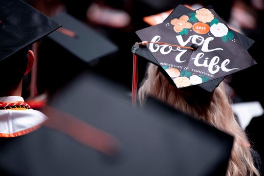 Graduates wear decorated caps at the University of Tennessee winter graduation ceremony in Thompson-Boling Arena in Knoxville on Friday, Dec. 13, 2019.