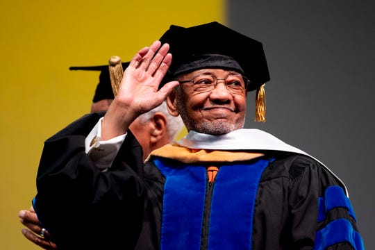 Theotis Robinson Jr. is presented an honorary degree at the University of Tennessee winter graduation ceremony in Thompson-Boling Arena in Knoxville on Friday, Dec. 13, 2019.