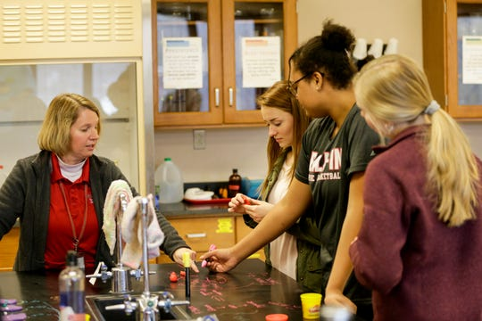 Becky Creech, left, takes her students through an exercise in her AP Biology class, Friday, Dec. 13, 2019 at West Lafayette Jr./Sr. High School in West Lafayette.