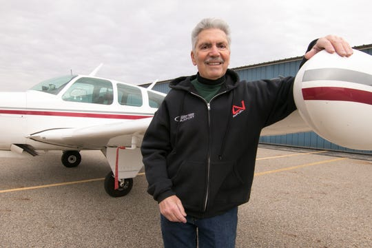 Mario Pecchia, an employee at the Spencer J. Hardy Airport in Howell, received the FAA Wright Brothers Master Pilot award. He stands at the wing of a 1967 Beechcraft Bonanza owned by his friend Ray Blach, outside a hangar at the airport Friday, Dec. 13, 2019.