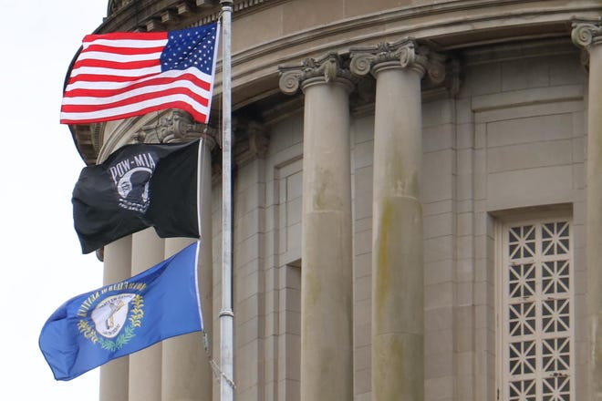 The POW/MIA flag in honor of missing and fallen soldiers flies above the Kentucky Capitol in Frankfort on Monday, Dec. 9, 2019.
