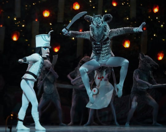 The Nutcracker battles the Mouse King during a dress rehearsal of the Nutcracker in Whitney Hall at the Kentucky Performing Arts on Dec. 12, 2019.