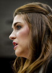 "Nassar survivor Sterling Riethman addresses the Michigan State University Board of Trustees, Friday, Dec. 13, 2019.   She said after eight months of hard work to move forward with an independent investigation, the Board of Trustees ""turned on us again,"" and impelled them to do better and cooperate with investigators now.  [AP Photo/Matthew Dae Smith/Lansing State Journal]"