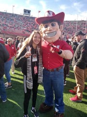 Galion track and field star Kerrigan Myers poses with Nebraska's mascot while attending a football game against Wisconsin on her recruiting visit