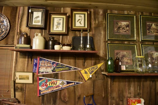 A pennant from the Lexington Minutemen is just own of many local items available at the antique store.