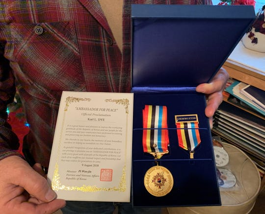 """Victor Holycross was presented with the Republic of Korea War Service Medal on behalf of his uncle, Pfc. Karl Lee Dye, during a ceremony on Aug. 9, 2018, in Washington, D.C.A letter that accompaniedthe medal reads in part: """"In grateful recognition of your dedicated contributions, it is our privilege to proclaim you an 'AMBASSADOR FOR PEACE' with every good wish of people of the Republic of Korea. Let us each reaffirm our mutual respect and friendship that they may endure for generations to come."""""""