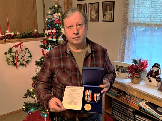 Victor Holycross holds the Republic of Korea War Service Medal that was presented posthumously to his uncle, Pfc. Karl Lee Dye. Dye, who served in the U.S. Army in the Korean War, was killed in Korea on July 16, 1950, less than a month after he was deployed there. Dye's remains were not positively identified until 2018. He will be interred in April 2020 at Arlington National Cemetery in Virginia.