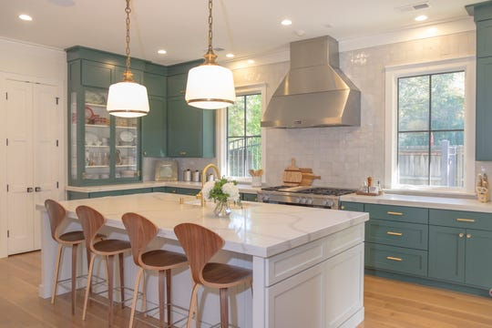Josh and Lindsey Black (especially Lindsey)  designed this functional  kitchen with clean lines and stainless steel appliances. It is a cook's delight with plenty of storage and prep space.