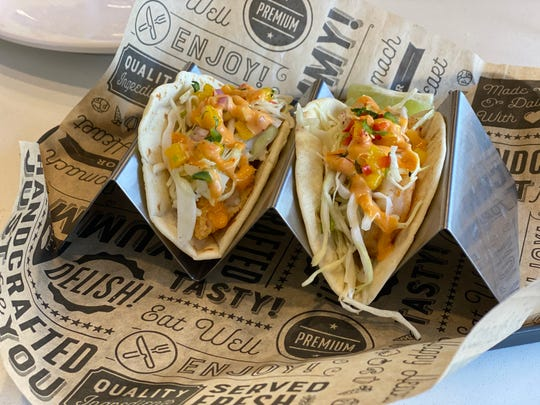 Shrimp Tacos at Kohesian Soko Style Eatery in Germantown. Grilled or fried shrimp are topped with mango salsa, slaw and a Korean sweet heat sauce.