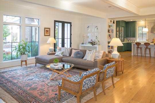 Josh and Lindsey Black's living room is a comfortable space with subtle tones decorating that  portion of the open floor place with a multi-colored area rug that ties it all together.