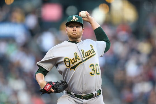 Aug 13, 2019; San Francisco, CA, USA; Oakland Athletics starting pitcher Brett Anderson (30) throws a pitch during the first inning against the San Francisco Giants at Oracle Park. Mandatory Credit: Sergio Estrada-USA TODAY Sports