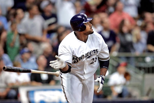 Prince Fielder tosses his bat aside while he  watches his second home run of the night against the St. Louis Cardinals on Sept. 25, 2007. It was his 50th home run of the year.