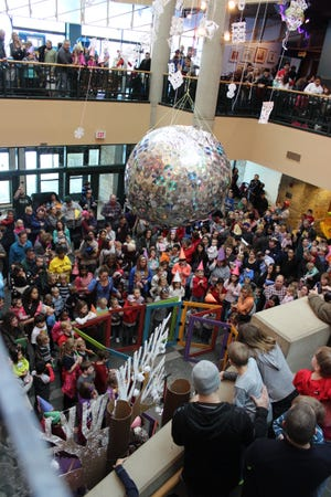 Families ring in the new year at noon at Betty Brinn Children's Museum in 2016.
