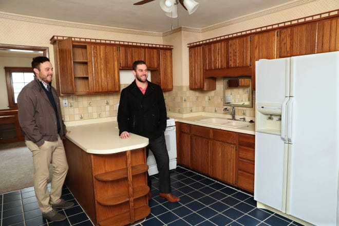 Real estate agent Ryan Stefaniak, left, of The Stefaniak Group, shows a home at 860 S. 76th St. in West Allis to first-time home buyer Andy Jaynes, who currently rents in Milwaukee.
