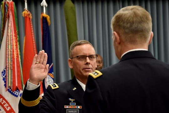 Incoming U.S. Army Space and Missile Defense Command commanding general Lt. Gen. Daniel L. Karbler, is promoted before the change of command at SMDC's Redstone Arsenal, Alabama, headquarters on Dec. 6. Karbler is a native of Hartland and a graduate of Arrowhead High School.