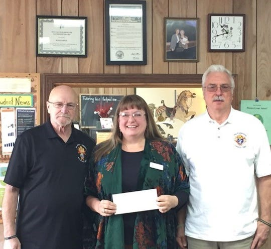 The Knights of Columbus, Council 7353 of St. Peter the Fisherman Catholic Church , held their annual Paul Bunyan Breakfast fundraiser in November. They donated the proceeds of their work to the Twin Lakes Literacy Council. Funds will help to provide free tutoring to adults and academically at-risk children in reading, basic math, English, citizenship, and basic computer skills. Pictured from left are Frank Holt, Heather Powell, and Bob Anderson.