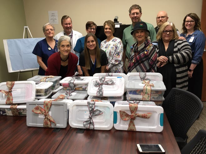 Christmas gift boxes were recently presented to the Mountain Home Outpatient Veteran's Clinic by members of the Captain Nathan Watkins Chapter of the Daughters of the American Revolution. Pictured above are VA employees and DAR members and include (first row, left to right) Cindy Hutchison, Ashley Owens, April Baily, Rita Barker (second row, left to right)  Debbie Braswell,  Allen Benz, Launa Clarke, Margie Topping, Steven Vlack, Clay Allen and Amber Runsick.