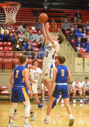 Mountain Home's Mat Jones puts up a shot during recent action at Branson, Mo. Jones scored 18 to lead the Bombers past Beebe on Thursday night.