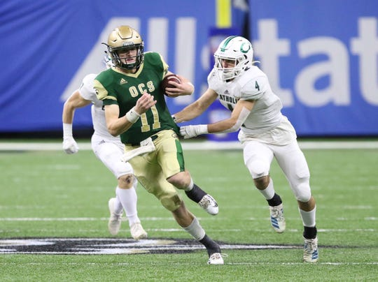 Ouachita Christian quarterback Hunter Herring (11), a new UL commit, runs during the 2019 LHSAA Division IV state title game at the Superdome in New Orleans.
