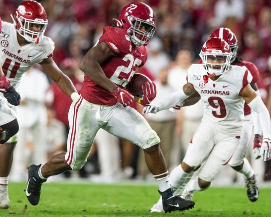 Alabama running back Najee Harris (22) carries against Arkansas at Bryant-Denny Stadium in Tuscaloosa, Ala., on Saturday October 26, 2019.