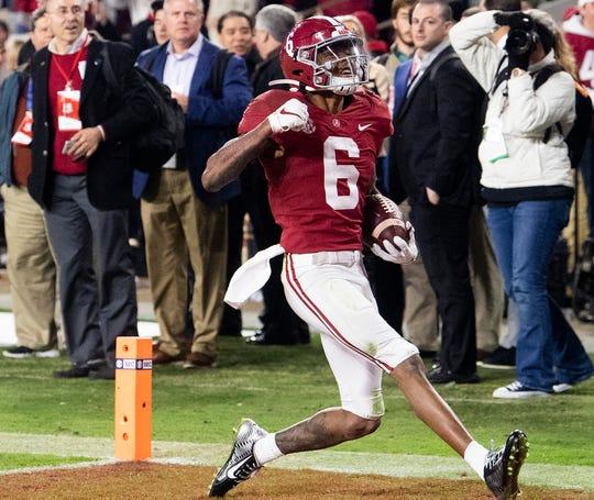 Alabama wide receiver DeVonta Smith (6) scores late against LSU at Bryant-Denny Stadium in Tuscaloosa, Ala., on Saturday November 9, 2019.