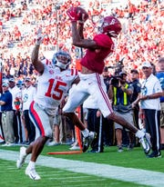 Alabama wide receiver DeVonta Smith (6) catches his fifth touchdown of the day against Ole Miss at Bryant-Denny Stadium in Tuscaloosa, Ala., on Saturday September 28, 2019.