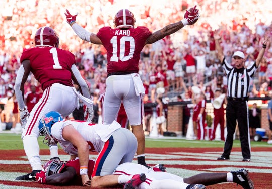 Alabama linebacker Ale Kaho (10) celebrates his touchdown after he recovered a blocked punt in the end zone against Ole Miss at Bryant-Denny Stadium in Tuscaloosa, Ala., on Saturday September 28, 2019.