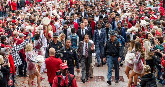 Alabama head coach Nick Saban leads his team in the Walk of Champions before the Alabama vs. Western Carolina game on the UA campus in Tuscaloosa, Ala., on Saturday, November 23, 2019.