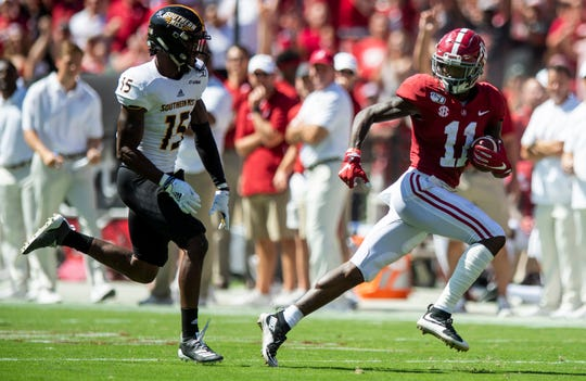 Alabama wide receiver Henry Ruggs, III, (11) runs away from Southern Miss defensive back Shannon Showers (15) on a long touchdown catch at Bryant-Denny Stadium in Tuscaloosa, Ala., on Saturday September 21, 2019.