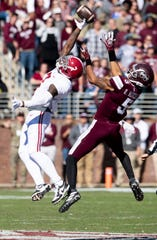 Alabama defensive back Trevon Diggs (7) breaks up a pass intended for Mississippi State wide receiver Osirus Mitchell (5) at Davis Wade Stadium on the MSU campus in Starkville, Ms., on Saturday November 16, 2019.