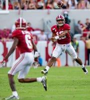 Alabama quarterback Tua Tagovailoa (13) passes to wide receiver DeVonta Smith (6) at Bryant-Denny Stadium in Tuscaloosa, Ala., on Saturday September 28, 2019.